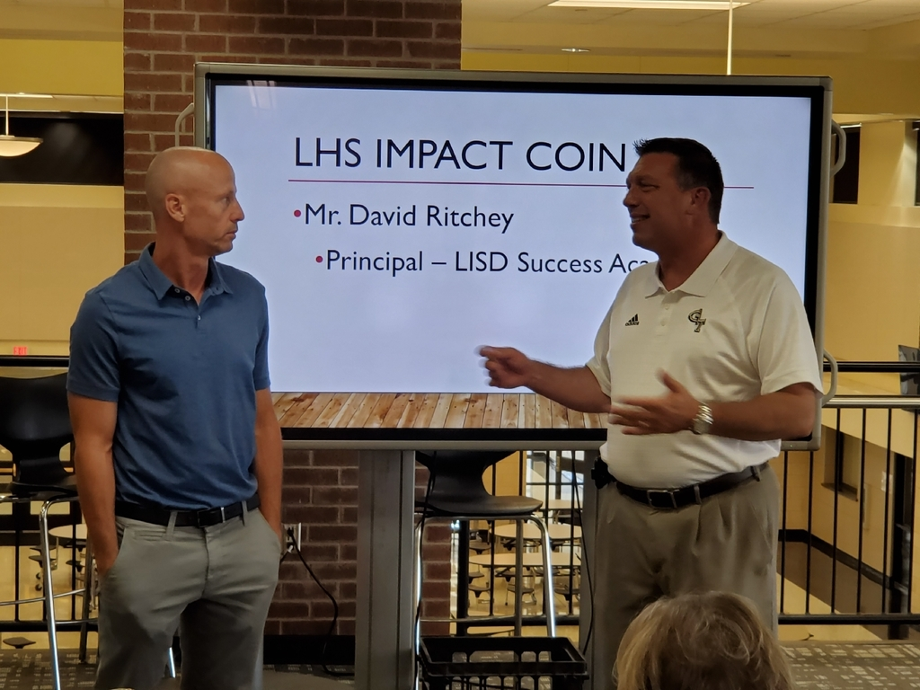 Ritchey is seen receiving the Impact Coin from LHS principal Jerry Jerabek.